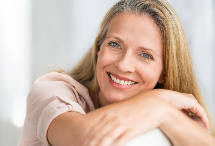 middle aged woman with artificial teeth